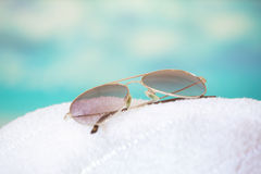 Sunglasses at the beach Stock Photo