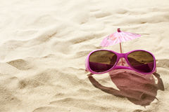 Sunglasses on beach concept Royalty Free Stock Photos