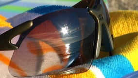 Sunglasses with beach gear stock video footage