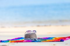 Sunglasses and Beach hat on the beach. Sunglasses and Beach hat on sand beach stock photography