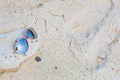 Sunglasses on the beach. Sunglasses lying on the beach, white sand stock images