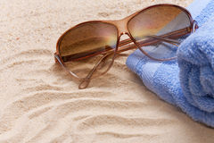 Sunglasses on the beach Stock Images