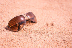 Sunglasses on beach Royalty Free Stock Photos