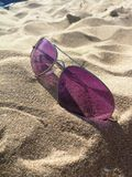Sunglasses on the beach sand stock photos