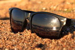 Sunglasses on the beach. For  the season on the sea Royalty Free Stock Image