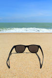 Sunglasses on the beach Stock Photography