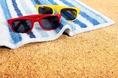 Sunglasses beach sunbathing copy space Royalty Free Stock Photography