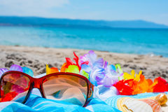 Sunglasses and beach towel Stock Image