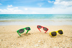 Sunglasses at the beach Royalty Free Stock Photography
