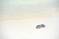 Sunglasses on the beach Royalty Free Stock Photo