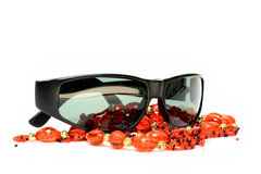 Sunglasses and beads Royalty Free Stock Image