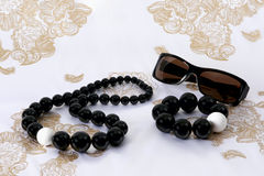 Sunglasses, Beads And Bracelet On Scarf Royalty Free Stock Image