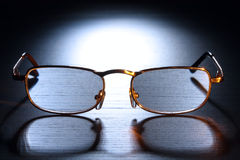 Sunglasses in beam of light Royalty Free Stock Photos