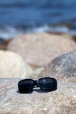 Sunglasses on a big rock Royalty Free Stock Images