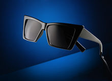 Sunglasses on blue background Royalty Free Stock Image