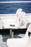 Sunglasses on boat open deck seats. Stock Photo