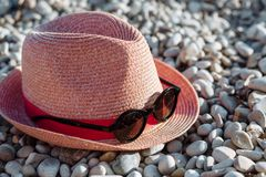 Sunglasses and a bonnet on the beach stock photos