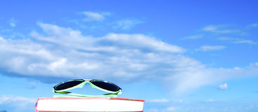 Sunglasses on book at the beach Royalty Free Stock Images