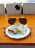 Sunglasses and breakfast Stock Images