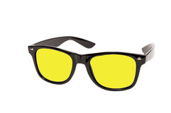 Sunglasses With Bright Colored Lenses. Black rimmed sunglasses with bright colored lenses, horizontal shot and isolated on a white background Stock Photos