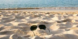 Sunglasses on a caribbean beach Stock Photos