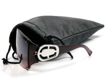 Sunglasses in case. Modern sunglasses in a case with a white background stock photo