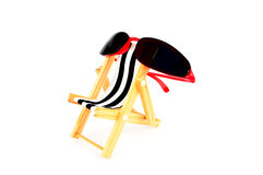 Sunglasses and Chaise Royalty Free Stock Images