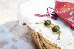 Sunglasses, Chinese Fan and Picnic Basket on Blank Royalty Free Stock Image
