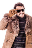 Sunglasses and coat Stock Photos