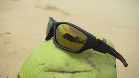 Sunglasses on coconut stock video footage