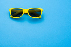 Sunglasses on colorful background with copy space Stock Photos