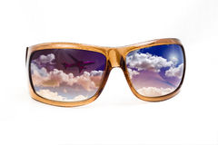 Sunglasses with concept reflection. A pair of sunglasses with reflection of flight and sunshine suggestive of view to holidays stock photography