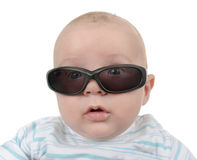 Sunglasses. Cool baby kid looking through sunglasses Stock Photography