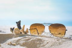 Sunglasses and Coral on the sand. Sunglasses and Coral on the sand Royalty Free Stock Image
