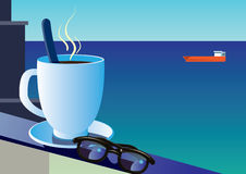 Sunglasses and cup of coffee on the background of the sea  Stock Photography