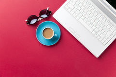 Sunglasses and cup of coffee near notebook Royalty Free Stock Photography