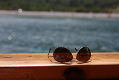 Sunglasses on the deck Royalty Free Stock Images