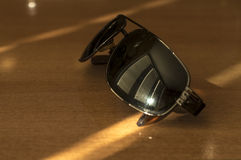 Sunglasses on the desk Stock Images