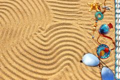 Sunglasses and  different objects on the beach sand Royalty Free Stock Photo