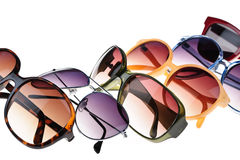Sunglasses. Different styles of tinted sunglasses on white background Stock Images