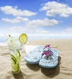 Sunglasses drink in sand on beach. At sea holiday concept Royalty Free Stock Image
