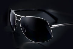 Sunglasses. Fashion sunglasses on dark background Stock Photos