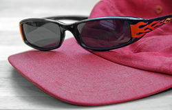Sunglasses flames and cap stock images