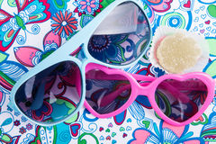 Sunglasses in the form of heart with fruit candy Stock Photos