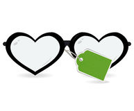 Sunglasses in the form of heart with label isolated on a white Stock Image