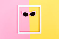 Sunglasses and frame on split background Stock Images