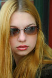 Sunglasses Girl. Girl wearing sunglasses royalty free stock images