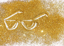 Sunglasses of golden glitter sparkle on white background Stock Photography