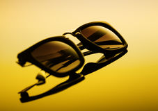 Sunglasses on a gradient background stock photography