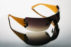 Sunglasses on grey background Royalty Free Stock Image